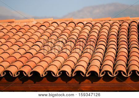 Red clay roof tiles. Built. Detail .