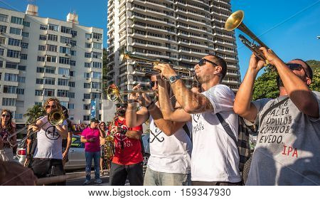 27 November, 2016. Music band playing trombones and saxophone in the street at Festival Fanfare Activist Festival de Fanfarras Ativistas - HONK RiO 2016 near Leme district, Rio de Janeiro, Brazil