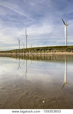 Windmills on the Maasvlakte beach near the port of Rotterdam