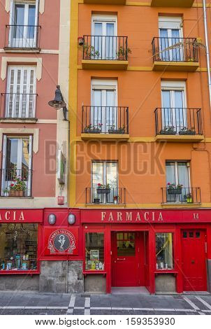 PAMPLONA, SPAIN - NOVEMBER 2, 2016: Colorful farmacy shop in the histrorical center of Pamplona, Spain