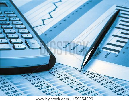 Calculator and Pen on the investment Chart