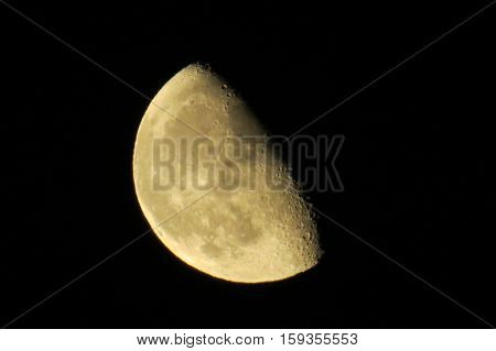 Waning gibbous moon in a dark sky