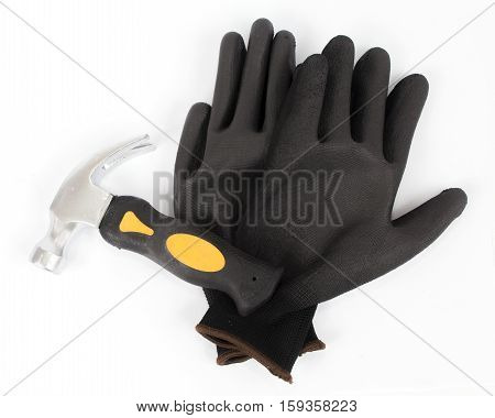 hammer and black protective nitrile gloves on white background