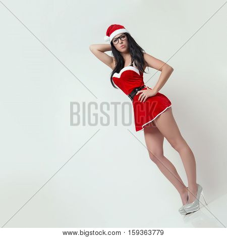 very beautiful and sexy woman dresses as a sexy santa claus