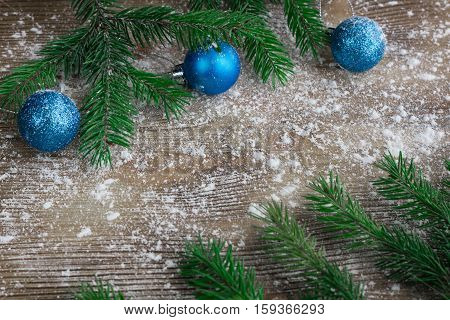 Christmas Tree Branches, Blue Balls On Winter Snowed Wooden Background