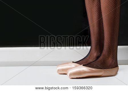 Female Legs In Ballet Shoes