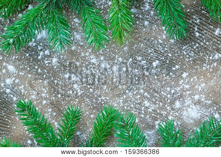 Christmas Tree Green Branches On Winter Snowbound Wooden Background