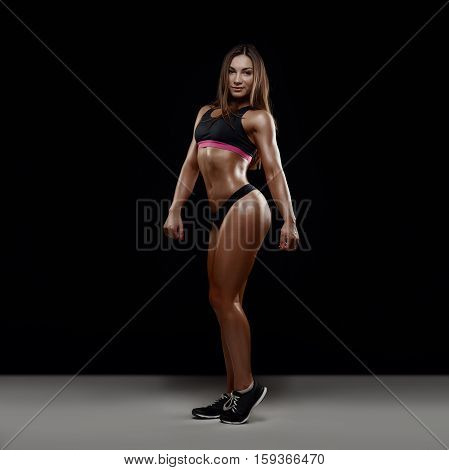 Young beautiful fitness brunette woman in studio