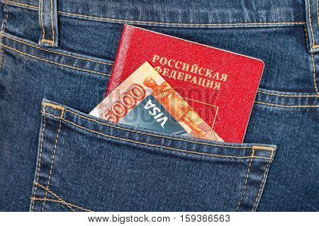 MOSCOW RUSSIA - NOVEMBER 27 2016: Russian passport money and credit card Visa in back jeans pocket. Travel concept