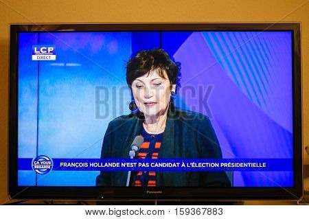 PARIS FRANCE - DEC 1 2016: Journalist debates as Francois Hollande at French Television address to the Nation that he will not seek re-election as president of France