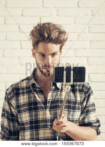 Handsome Man Uses Selfie Stick
