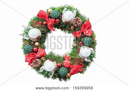 With Ribbons, Baubles And Candles Decorated Evergreen Yew Wreath For Christmas