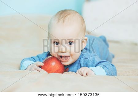Little Happy Baby With Red Apple