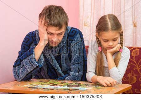 My Daughter Collects A Picture From Puzzles, Tired Dad Sitting Next