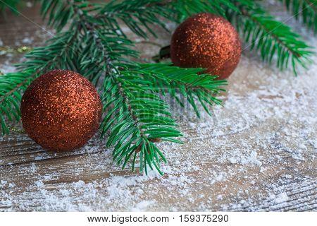 Christmas Tree Green Branches, Orange Balls, Winter Snowbound Wooden Background