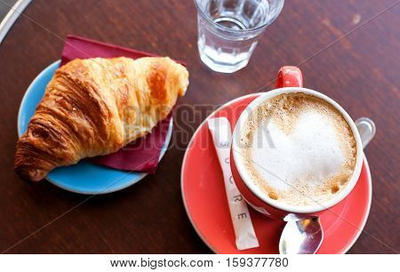 Tasty Breakfast In A Parisian Street Cafe - Cup Of Coffee, Croissant And Glass Of Water