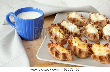 Traditional Karelian Pasties With Cup Of Milk