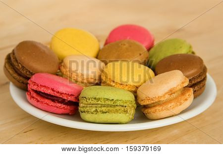 Traditional French Dessert. Multicolored Macaroon Cookies Served On A Plate