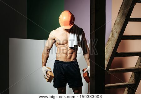 Sexy Muscular Man Builder On Ladder