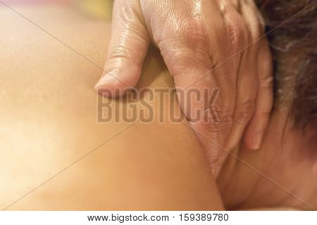 Close Up Of Hands Massaging Female Neck And Shoulders.