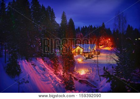 Wooden house in forest at winter