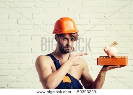 Sexy Muscular Man Builder With Moneybox