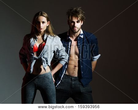 Young Couple In Unbutton Shirts