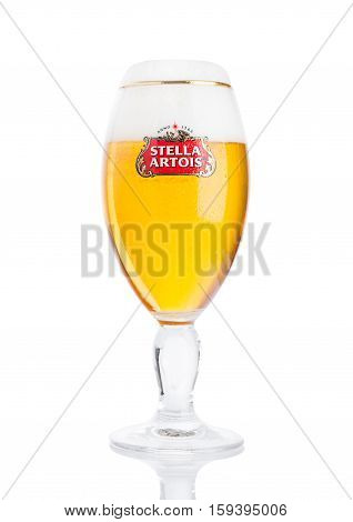 LONDON UK -NOVEMBER 29. 2016 Cold glass of Stella Artois beer on white background prominent brand of Anheuser-Busch InBev is a pilsner brewed in Leuven Belgium since 1926