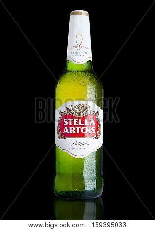 LONDON UK -NOVEMBER 29. 2016 Cold Bottle of Stella Artois beer on black background prominent brand of Anheuser-Busch InBev is a pilsner brewed in Leuven Belgium since 1926