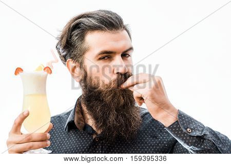 handsome bearded man with stylish hair mustache and long beard on satisfied face holding glass of nonalcoholic cocktail isolated on white