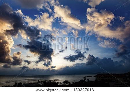 A view over Nha Trang bay at sunrise with a dramatic cloudy sky.