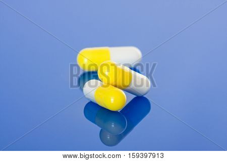 Pharmaceuticals on blue background