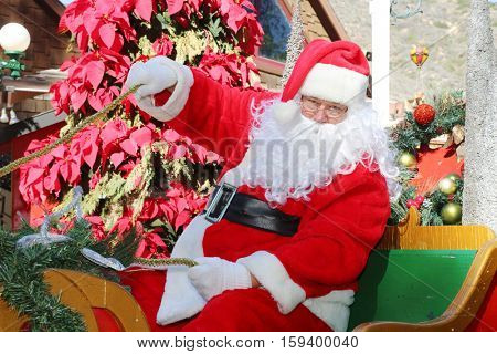 Santa Claus in his Santa Sleigh. Santa rides in his Sleigh bringing gifts to boys and girls around the world. Christmas Images and concepts. Sleigh. Sled.
