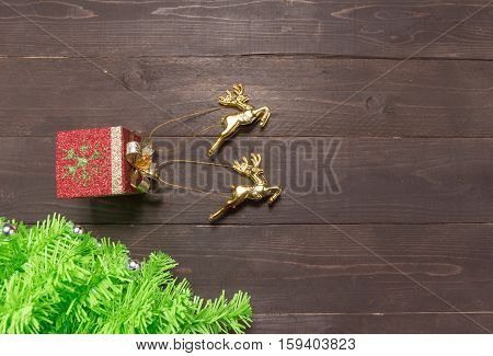 Christmas Tree And Reindeers Are On On The Wooden Background