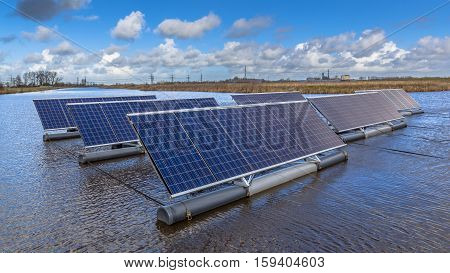 Close Up Of Group Of Photovoltaic Panels Floating On Water
