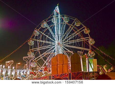 HOWRAH WEST BENGAL INDIA - MARCH 1ST MARCH 2015 : Roller coster ride at Howrah West Bengal India. Shot at night with colored lights.