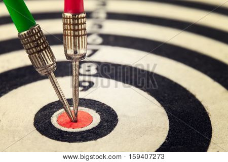 Two arrow dart hit the center of the target dartboard abstract of Business competition