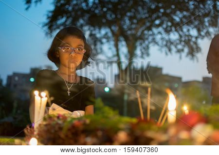 KOLKATA WEST BENGAL INDIA - NOVEMBER 2ND 2014 : Unknown child remembering relative at