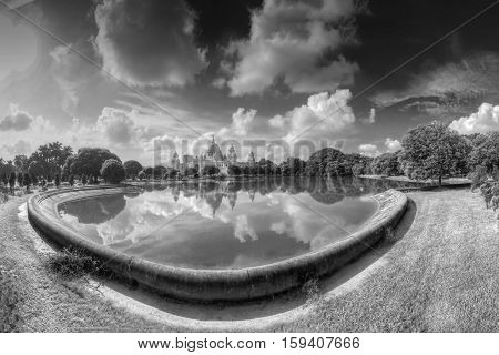 Beautiful panoramic image of Victoria Memorial Kolkata Calcutta West Bengal India . A Historical Monument of Indian Architecture. Huge lake in foregreound black and white stock image.
