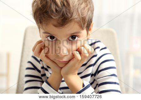 Portrait of cute little boy indoors