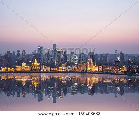 beautiful shanghai bund in nightfall reflection on the huangpu river high angle view