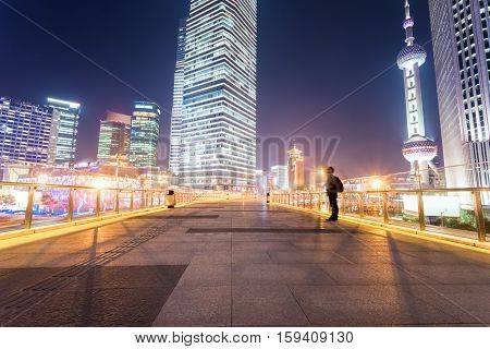shanghai cityscape on the pedestrian bridge at night abstract blankly city background