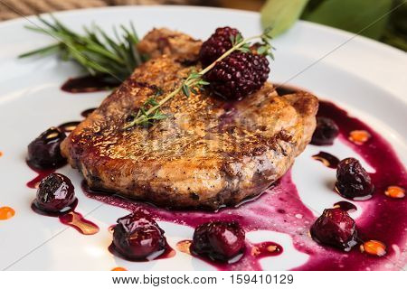 Pork Steak On The Bone With Cherry-ginger Sauce