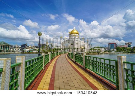 The famous of Sultan Omar Ali Saifuddien Mosque in Brunei Darusallam with blue sky background.The beautiful building architecture & attraction places in Brunei Darussalam.