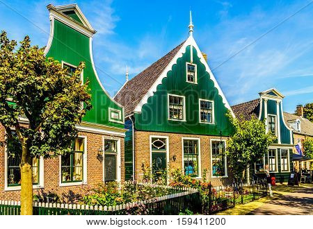Traditional Dutch village Houses in the Historic town of Zaanse Schans on the Zaan River in the Netherlands