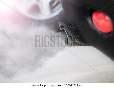 Exhaust fumes pipe during starting engine of a black car
