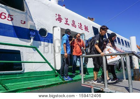 Kota Kinabalu,Sabah-Nov 28,2016:Passengers express ferry arrived from Labuan island in Jesselton terminal,Kota Kinabalu,Sabah.Its a main tourist attraction & cheaper transportation to Labuan Island.