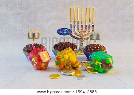 Jewish holiday Hanukkah cupcakes Gourmet cupcakes decorated with white and blue icing for Hanukkah. Jewish holiday A still life composed of elements of the Jewish Chanukah Hanukkah festival.