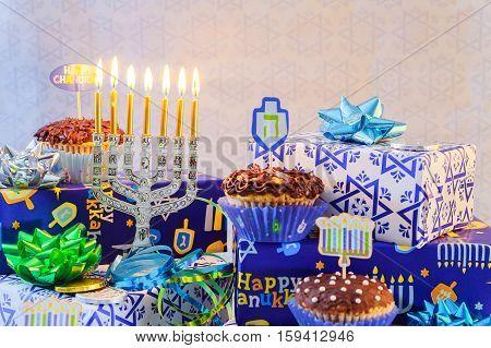 Jewish holiday hanukkah celebration with vintage menorah tallit