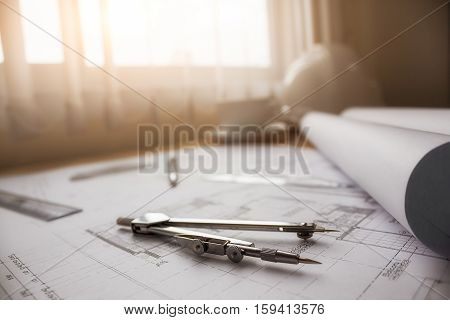 Desk of Engineering project in construction site or office with morning light. Construction concept. Engineering tools.Vintage tone retro filter effectsoft focus(selective focus)